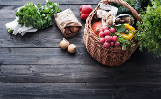 Fresh Vegetables in a Shopping Basket on a Wooden Table
